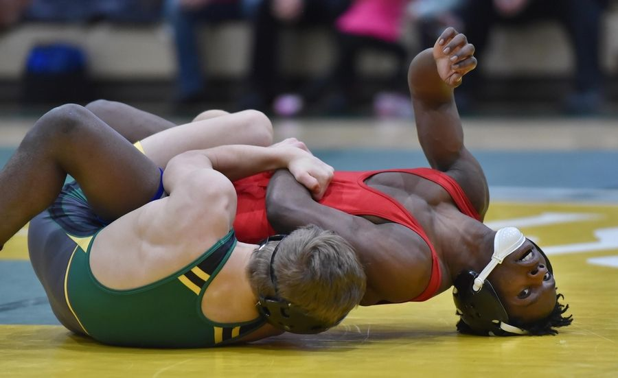 Fremd's Charlie Fifield control's Dundee-Crown's Amaire Jones in their 126-pound championship bout at the Stevenson High School wrestling regional meet in Lincolnshire Saturday.