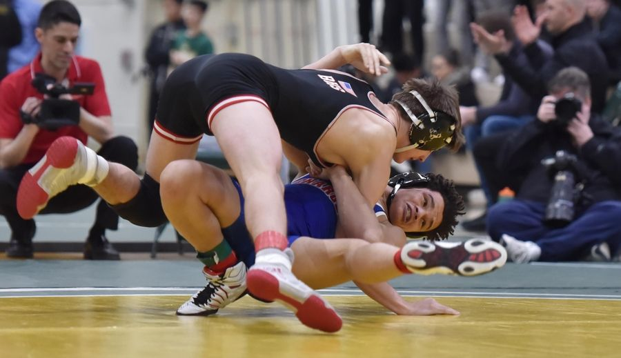 Dundee-Crown's Gabriel Scales throws Barrington's Trey Cysewski in their 145-pound title bout at the Stevenson High School wrestling regional meet in Lincolnshire Saturday.