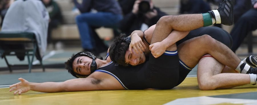 Barrington's Kai Conway controls Highland Park's Pano Dosos in their 160-pound title bout at the Stevenson High School wrestling regional meet in Lincolnshire Saturday.