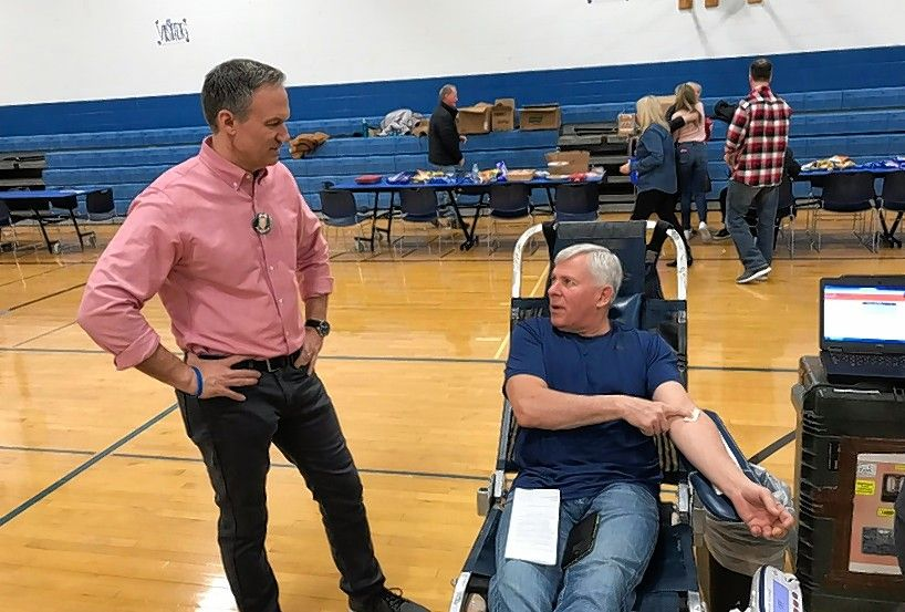 Tom Holum, left, talks with his friend Kevin Lowe of Arlington Heights at Sunday's blood drive at Our Lady of the Wayside School.
