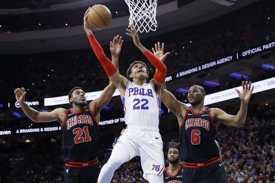 Philadelphia 76ers' Matisse Thybulle (22) goes up for a shot between Chicago Bulls' Cristiano Felicio (6) and Thaddeus Young (21) during the second half of an NBA basketball game, Sunday, Feb. 9, 2020, in Philadelphia.