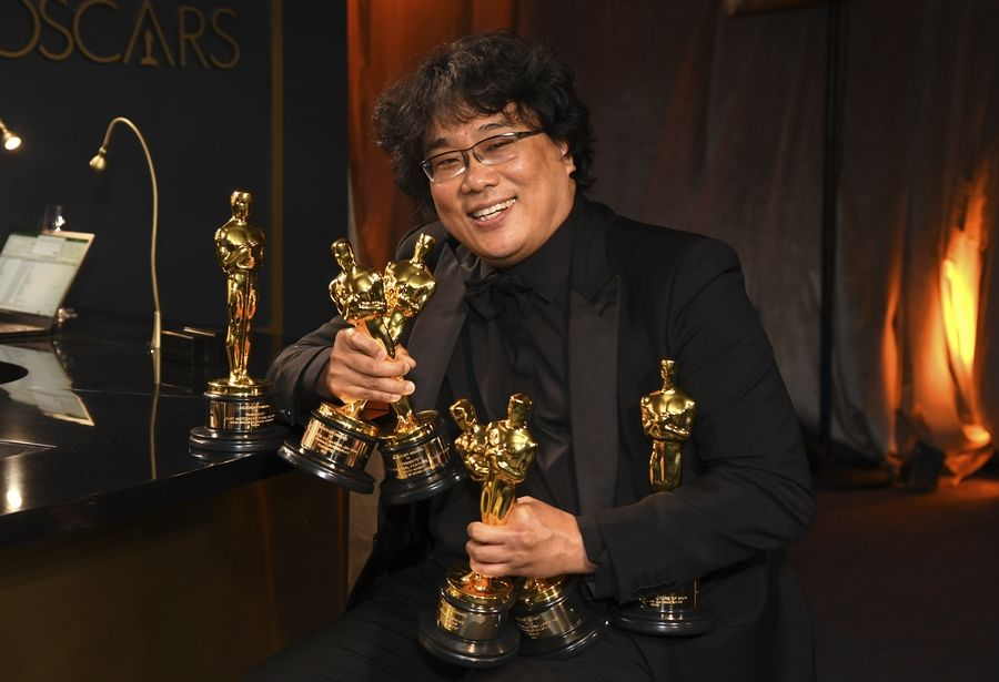 "Bong Joon Ho holds the Oscars won Sunday for his film ""Parasite."""