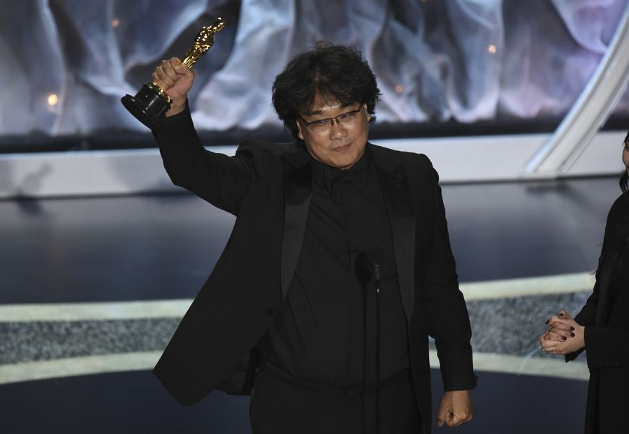 "Bong Joon Ho accepts the award for best International Feature Film for ""Parasite,"" from South Korea, at the Oscars on Sunday. The film also won Best Picture, among other awards."
