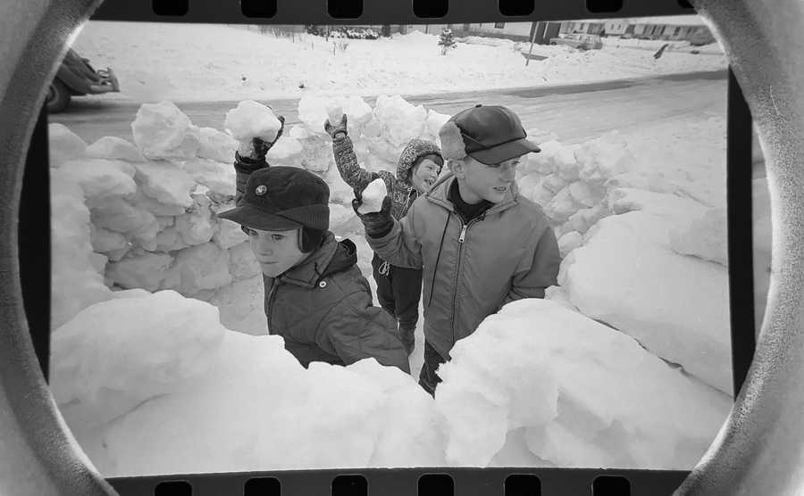 The Daily Herald Archive, Assignment # 2,836, Mike Seeling photo: After they saw other kids on their block in Elk Grove Village building snow forts, the Janos kids, John, right, Philip, left and Cindy decided they needed to build one too. They added a snow bench to sit on as well. The fort was constructed in January of 1966.