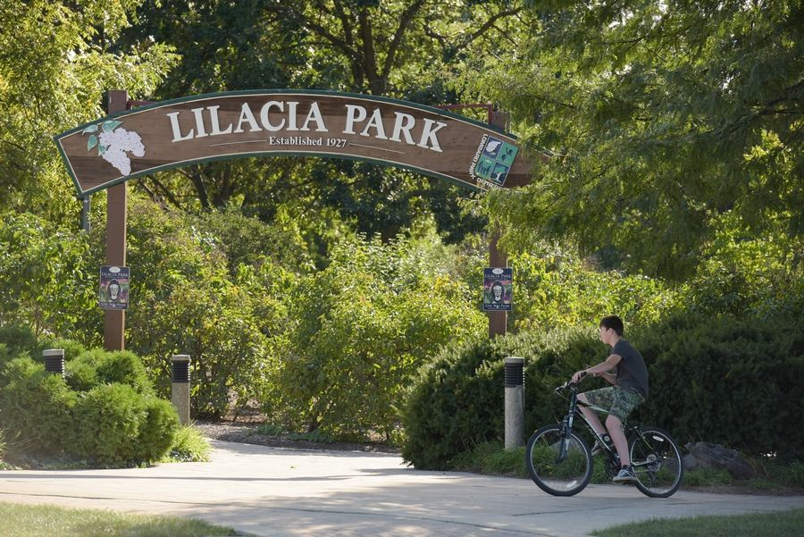 LILACIA PARK HISTORIC DISTRICT, Lombard: An archway marks the northeast entrance to Lilacia Park in Lombard. A 4.8-acre swath of the park has joined the National Register of Historic Places.