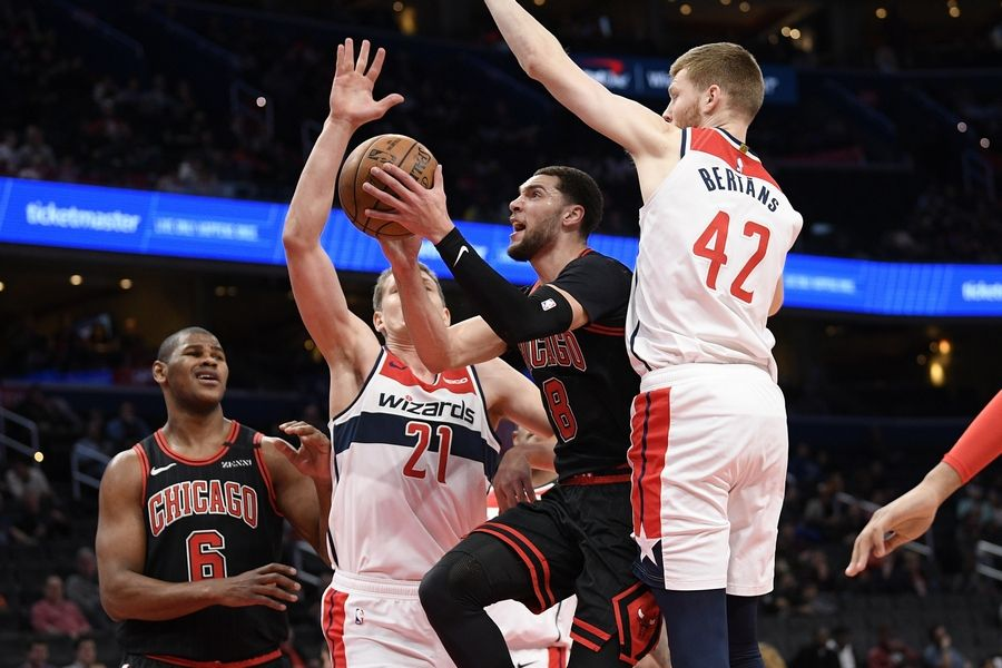 Chicago Bulls guard Zach LaVine (8) goes to the basket next to Washington Wizards forward Moritz Wagner (21) and forward Davis Bertans (42) during the first half of an NBA basketball game, Tuesday, Feb. 11, 2020, in Washington.