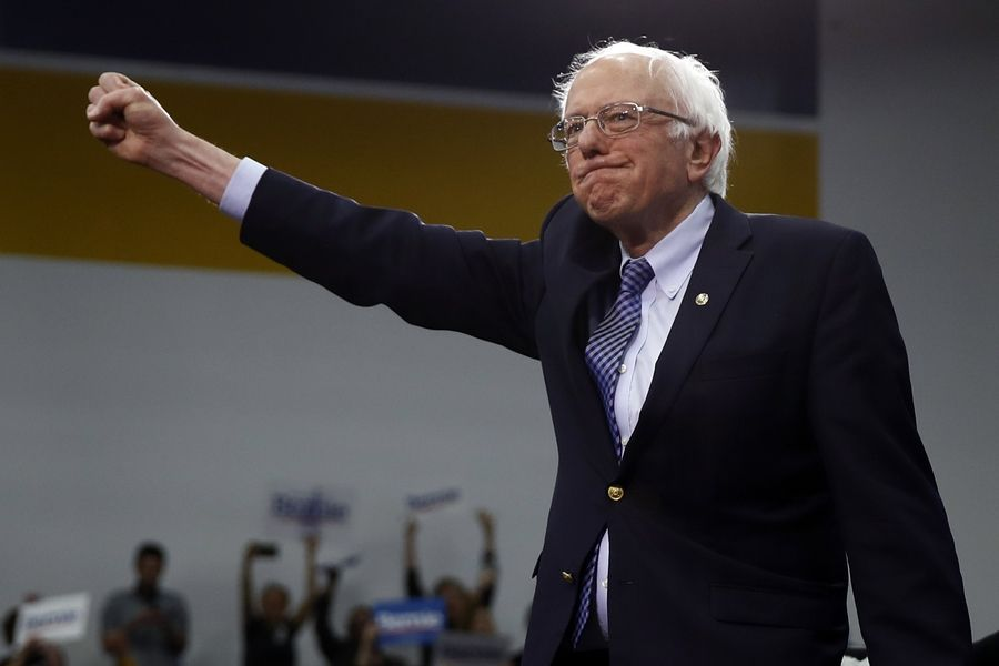 Democratic presidential candidate Sen. Bernie Sanders, a Vermont Independent, arrives Tuesday to speak to supporters at a primary night election rally in Manchester, New Hampshire.