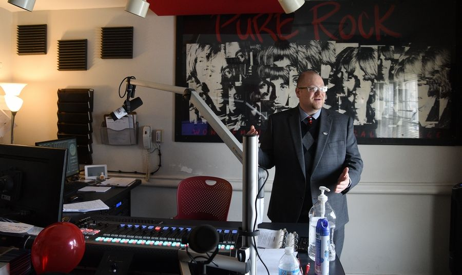 General Manager Zach DeWitz shows off new broadcast studio equipment Tuesday during an open house at WONC 89.1 FM, North Central College's student-run radio station in Naperville.