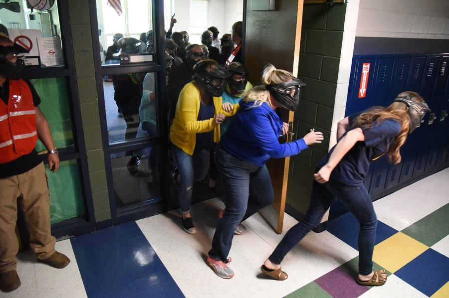 Teachers at Big Hollow Middle School in Ingleside participated in a 2018 active shooter drill that did not involve students. Lake County sheriff's deputies pretended to be attackers and the adults practiced how to react.