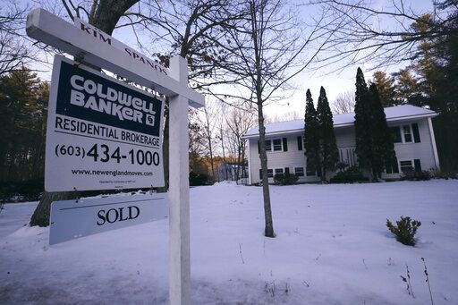 FILE - This Jan. 9, 2020, file photo shows a sold sign is posted on a real estate sign outside a home in Derry, N.H. On Thursday, Feb. 13, Freddie Mac reports on this week's average U.S. mortgage rates.