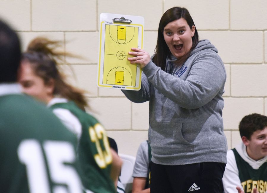 Allied basketball coach Emma Degen of Stevenson High School encourages players on the sidelines during a game at Lincolnshire school.