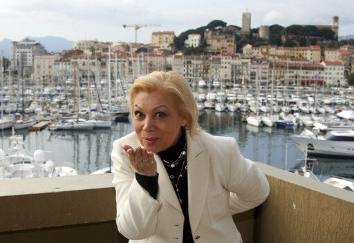 FILE - In this Tuesday Jan. 26, 2010 file photo, Italian opera soprano Mirella Freni poses at the 44th MIDEM (International record music publishing and video music market) in Cannes, southern France. Mirella Freni, an Italian soprano whose uncommon elegance and intensity combined with a sumptuous voice and intelligence to enthrall opera audiences for a half-century, has died at age 84. Freni's manager said she died Sunday Feb. 9, 2020 at her home in Modena, Italy.