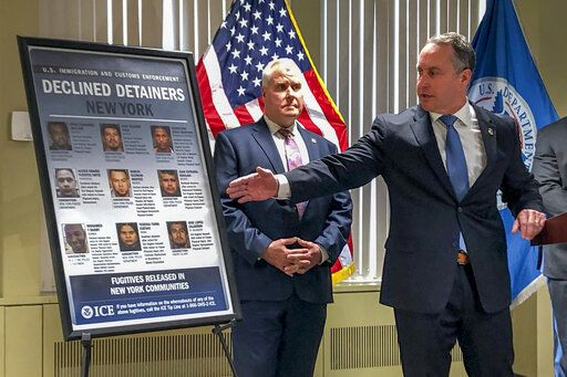 "Matthew Albence, right, the acting director of U.S. Immigration and Customs Enforcement, speaks during a news conference, Friday, Jan. 17, 2020, in New York. The country's top immigration official blamed the ""sanctuary policies"" of New York City on Friday for the sexual assault and killing of a 92-year-old woman, while the mayor's office decried such rhetoric as ""fear, hate and attempts to divide."""