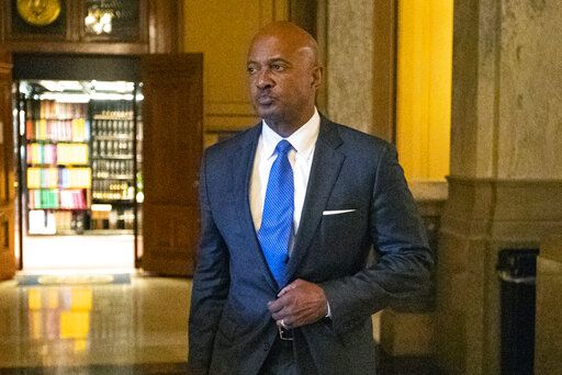 FILE - In this Oct. 23, 2019, file photo, Indiana Attorney General Curtis Hill arrives for a hearing at the state Supreme Court at the Statehouse in Indianapolis. A 60-day law license suspension is being recommended for Hill after allegations that he grabbed the buttocks of state Rep. Mara Candelaria Reardon, and inappropriately touched three other women during a party. The recommendation filed Friday, Feb. 14, 2020, with the state Supreme Court puts the Republican Hill's ability to remain as state government's top lawyer in jeopardy as he must have a law license to hold the position. It wasn't immediately clear how a temporary suspension would affect his status.