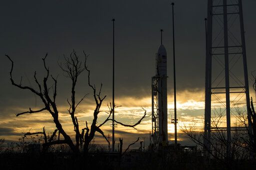 In this image provided by NASA, a Northrop Grumman Antares rocket carrying a Cygnus resupply spacecraft is seen at sunrise on Pad-0A, Friday, Feb. 14, 2020, at NASA's Wallops Flight Facility on Wallops Island, Va. High wind delayed Friday's launch to the International Space Station. It has been rescheduled for Saturday. (Aubrey Gemignani/NASA via AP)