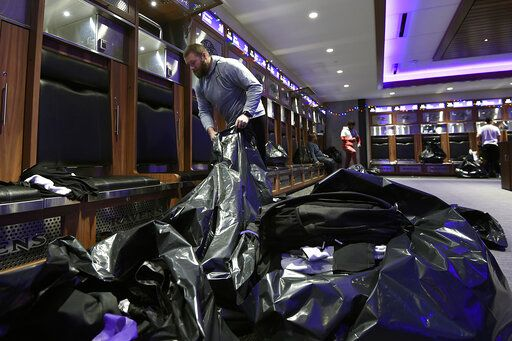 Baltimore Ravens guard James Hurst fills bags with items from his locker, Sunday, Jan. 12, 2020 in Owings Mills, MD.