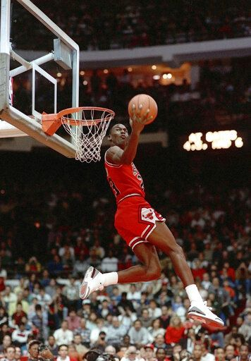 FILE - In this Feb. 6, 1988, file photo, Chicago Bulls' Michael Jordan dunks during the slam-dunk competition of the NBA All-Star weekend in Chicago.  Jordan left the old Chicago Stadium that night with the trophy. To this day, many believe Wilkins was the rightful winner.