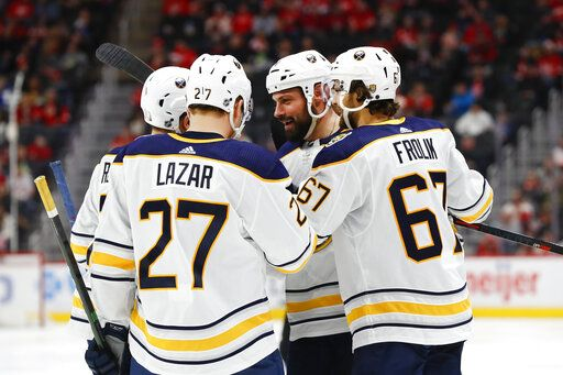 Buffalo Sabres defenseman Zach Bogosian, second from right, celebrates his goal with teammates in the third period of an NHL hockey game against the Detroit Red Wings, Sunday, Jan. 12, 2020, in Detroit.
