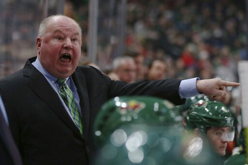 Minnesota Wild's head coach Bruce Boudreau shouts after a penalty call in the second period of an NHL hockey game against the Vancouver Canucks, Sunday, Jan. 12, 2020, in St. Paul, Minn.