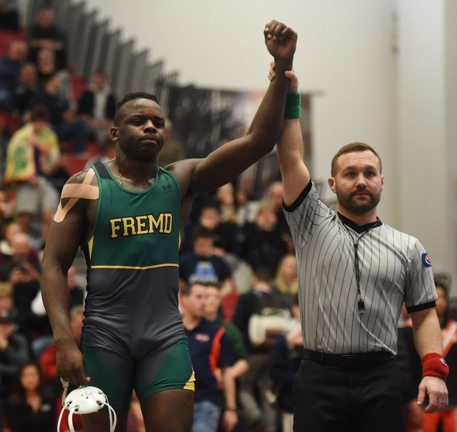 Fremd's Isiah Pettigrew is the winner of the 195-pound final against Prospect's Caleb Smith during the Barrington wrestling sectional Saturday.