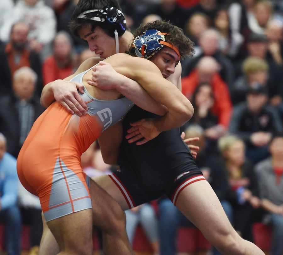 Barrington's Luke Rasmussen, right, defeats Evanston's Ricardo Salinas in the 170-pound final during the Barrington wrestling sectional Saturday.