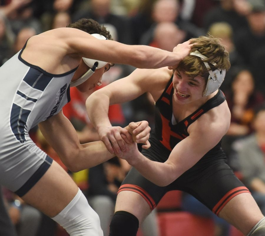 Huntley's Sam Spencer, right, competes with Belvidere's Antonio Alvarado in the 126-pound final during the Barrington wrestling sectional Saturday.