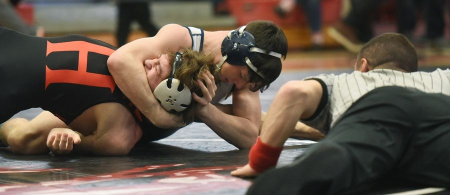 Prospect's Jack Milos, right, defeats Huntley's Andrew Lira in the 132-pound final during the Barrington wrestling sectional Saturday.