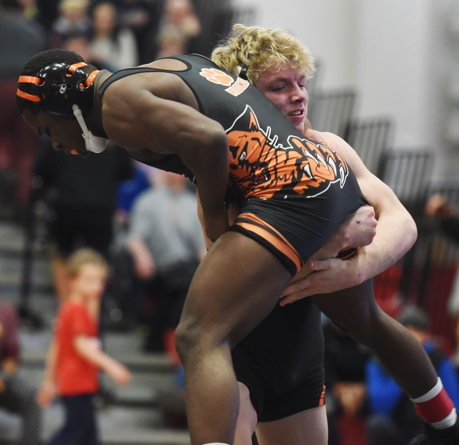 McHenry's Brody Hallin, right, wrestles Libertyville's E'lan Heard in the 152-pound final during the Barrington wrestling sectional Saturday.