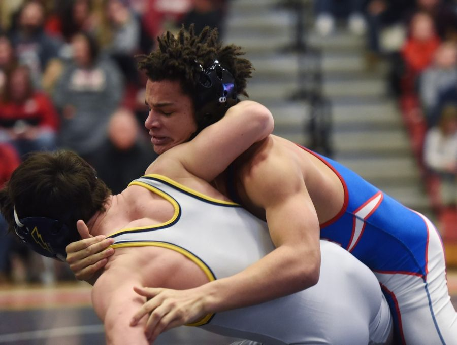 Dundee Crown's Gabriel Scales, top, and Glenbrook South's Will Collins compete in the 145-pound final during the Barrington wrestling sectional Saturday.