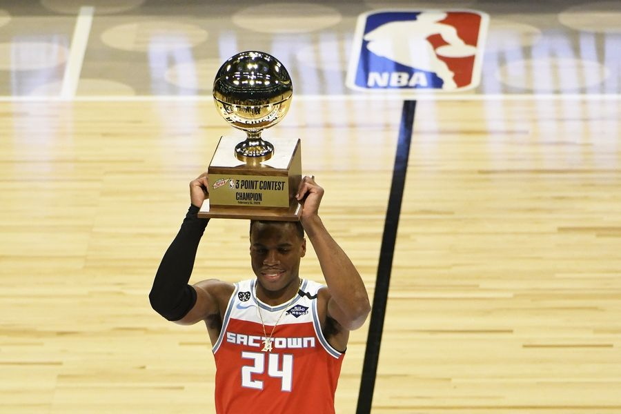 Sacramento Kings' Buddy Hield holds the trophy after winning the NBA basketball All-Star 3-point contest Saturday, Feb. 15, 2020, in Chicago.