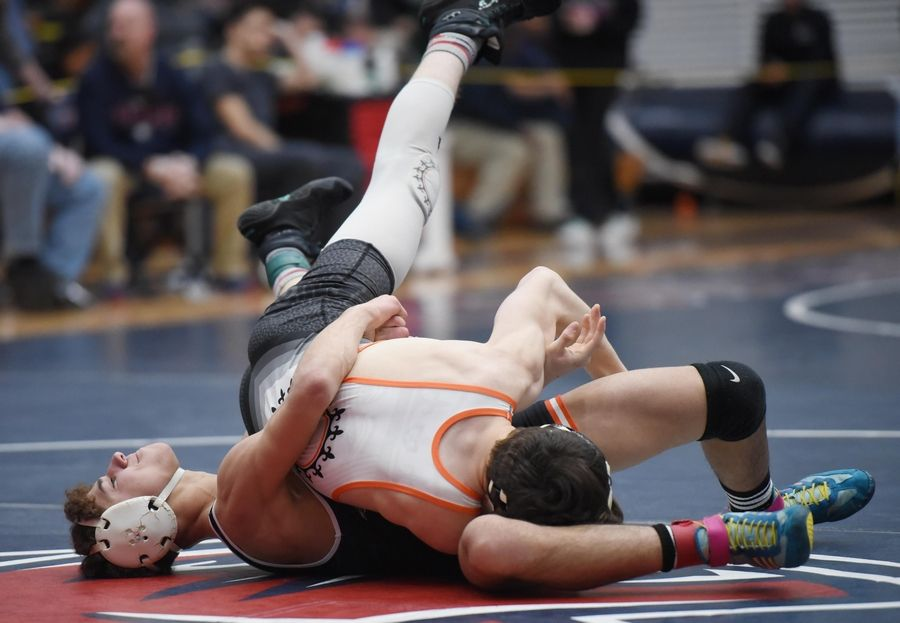 DeKalb's Tommy Curran and St. Charles East's Peyton Schroeder wrestle in their 132-pound championship bout at the Conant wrestling sectional meet Saturday in Hoffman Estates.