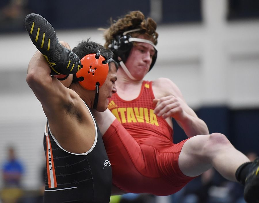 DeKalb's Fabian Lopez throws Batavia's Riley Woods wrestle in their 138-pound championship bout at the Conant wrestling sectional meet Saturday in Hoffman Estates.