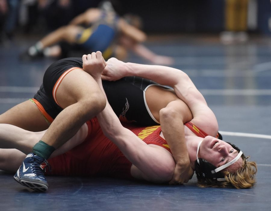 DeKalb's Fabian Lopez controls Batavia's Riley Woods wrestle in their 138-pound championship bout at the Conant wrestling sectional meet Saturday in Hoffman Estates.