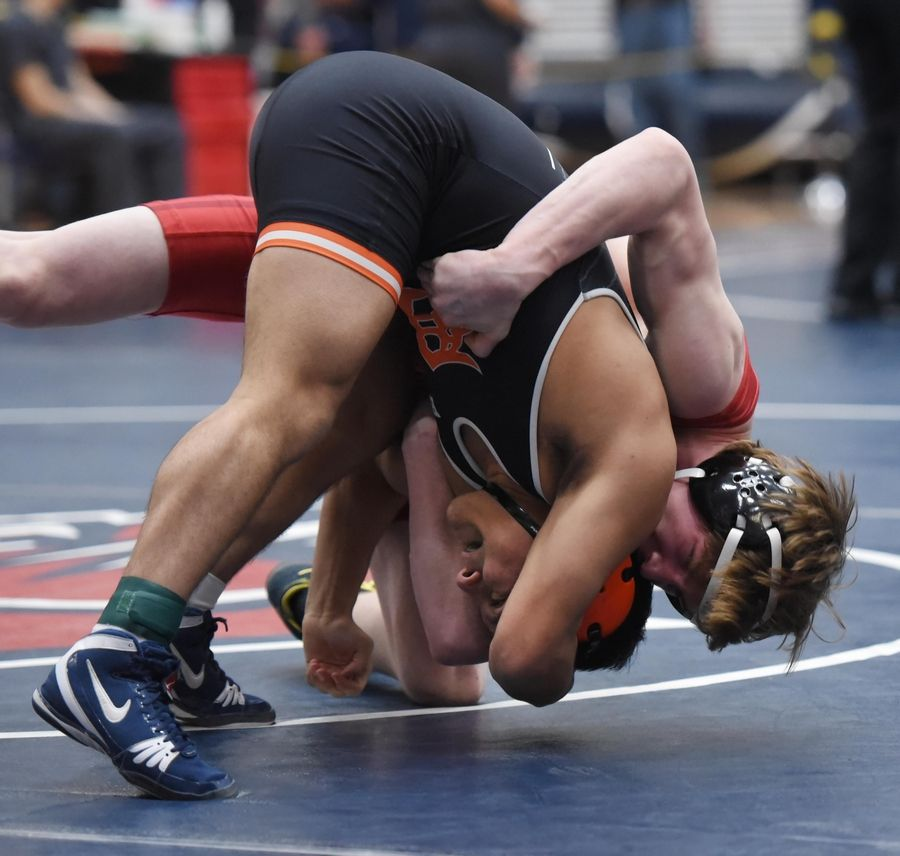 DeKalb's Fabian Lopez and Batavia's Riley Woods wrestle in their 138-pound championship bout at the Conant wrestling sectional meet Saturday in Hoffman Estates.