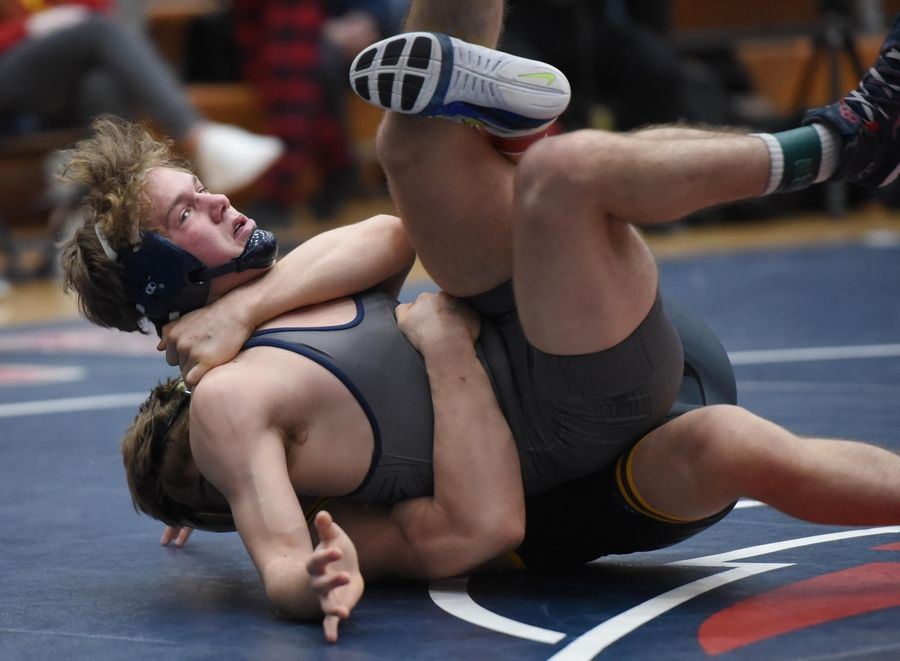 Montini's Joe Roberts and Addison Trail's Jake Matthews wrestle in their 152-pound championship bout at the Conant wrestling sectional meet Saturday in Hoffman Estates.