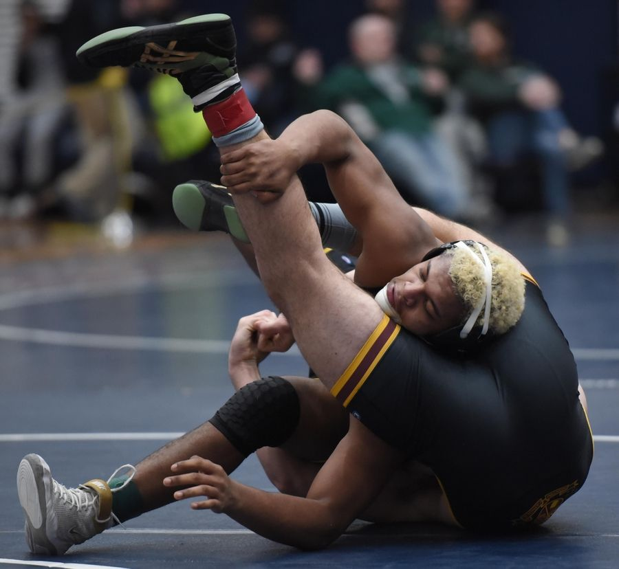 Montini's Trevor Swier wraps up Glenbard North's Alonzo Smiley wrestle in their 182-pound championship bout at the Conant wrestling sectional meet Saturday in Hoffman Estates.