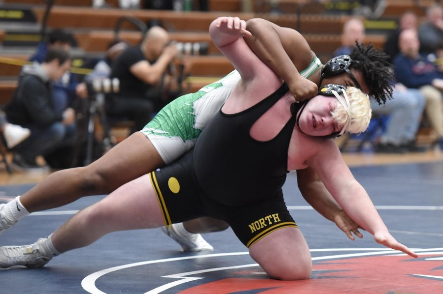 Glenbard North's Paulie Robertson and York's Josh Mathiasen wrestle in their 285-pound championship bout at the Conant wrestling sectional meet Saturday in Hoffman Estates.
