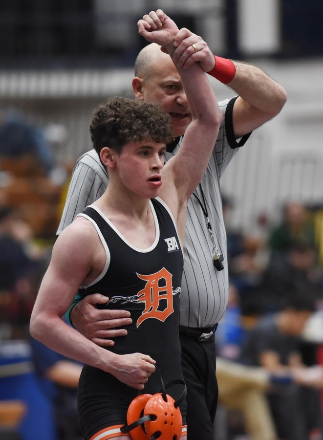 DeKalb's Ben Aranda is declared the winner over Glenbard East's Miguel Garcia in their 106-pound championship bout at the Conant wrestling sectional meet Saturday in Hoffman Estates.