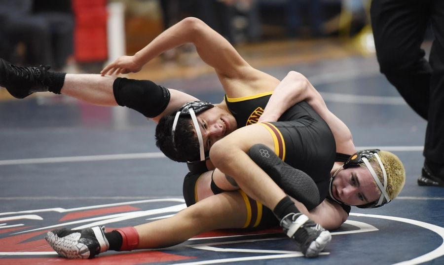 Montini's Nain Vazquez and Glenbrook North's Ronan Schuelke wrestle in their 120-pound championship bout at the Conant wrestling sectional meet Saturday in Hoffman Estates.