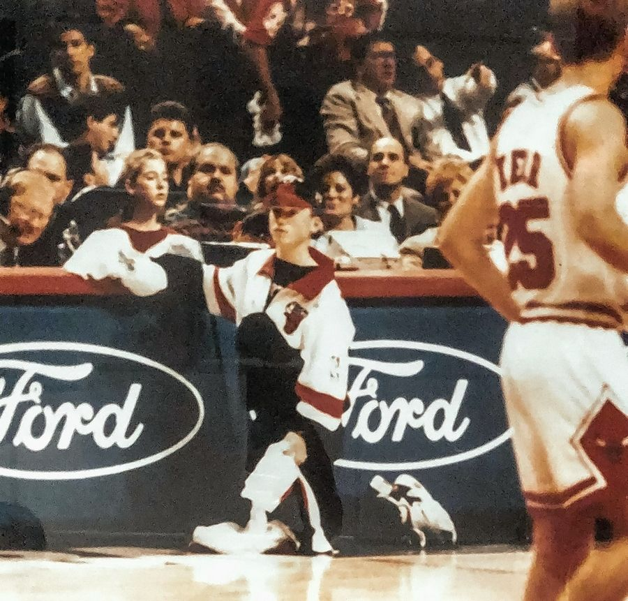 As a Chicago Bulls ball boy from 1996 through 1998, Deerfield's Jason Franklin, kneeling, got to meet players such as Michael Jordan, Scottie Pippen, Dennis Rodman and Steve Kerr, right. When Franklin went on his first date, Pippen chauffeured the young couple in his Ferrari.