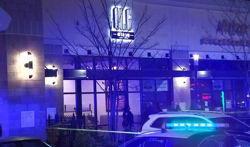 In this image from video provided by WSB-TV, police officers stand outside Old Lady Gang restaurant Friday, Feb. 14, 2020, in East Point, Ga. Three people were shot and wounded at the restaurant just outside Atlanta that's owned by singer and 'œReal Housewives of Atlanta'� star Kandi Burruss. A man entered the Old Lady Gang restaurant and targeted another man, East Point police Capt. Allyn Glover told news outlets. Police say two bystanders were also shot, and all three shooting victims suffered non-life-threatening injuries. (WSB-TV via AP)