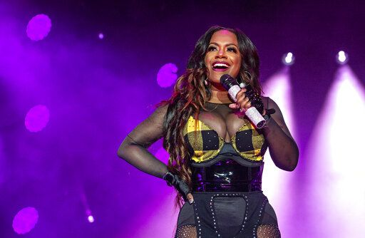 FILE - In this July 7, 2018, file photo, Kandi Burruss of Xscape performs at the Essence Festival at the Superdome in New Orleans. Three people were shot and wounded Friday, Feb. 14, 2020, at a restaurant just outside Atlanta that's owned by singer and 'œReal Housewives of Atlanta'� star Burruss. A man entered the Old Lady Gang restaurant and targeted another man, East Point (Ga.) police Capt. Allyn Glover told news outlets. Police say two bystanders were also shot, and all three shooting victims suffered non-life-threatening injuries. (Photo by Amy Harris/Invision/AP, File)