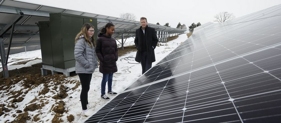 Big Hollow Elementary District 38 Superintendent Bob Gold with students Noelle Patrick, 13, of Ingleside and Meghan Klipstein, 13, of Lakemoor at the solar installation on campus set to go online in mid-March.