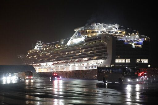 Buses carrying American passengers from the quarantined Diamond Princess cruise ship leave a port in Yokohama, near Tokyo, Monday, Feb. 17, 2020. A group of Americans are cutting short a 14-day quarantine on the Diamond Princess cruise ship in the port of Yokohama, near Tokyo, to be whisked back to America. But they will have to spend another quarantine period at a U.S. military facility to make sure they don't have the new virus that's been sweeping across Asia.