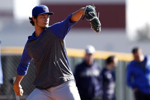 Chicago Cubs pitcher Yu Darvish throws during a spring training baseball workout Wednesday, Feb. 12, 2020, in Mesa, Ariz.