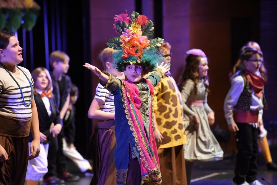 "Seth Paine Elementary School student Evan Kamin, playing the part of King Julian, the leader of a tribe of lemurs, dances and sings during a dress rehearsal of ""Madagascar: A Musical Adventure JR."" at Lake Zurich High School Tuesday."