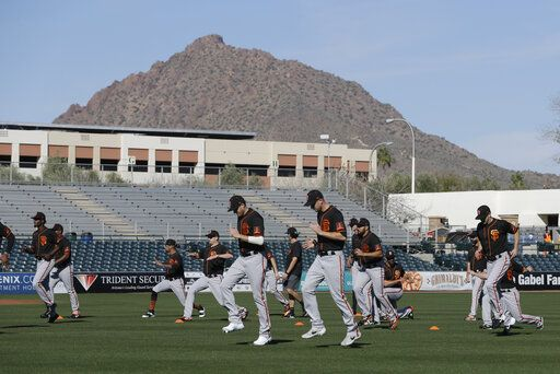 The San Francisco Giants run during spring training baseball practice, Friday, Feb. 14, 2020, in Scottsdale, Ariz.
