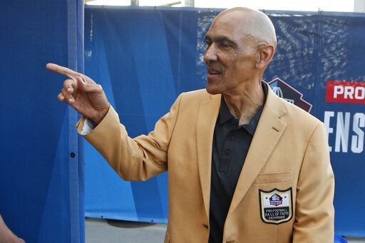 FILE - In this Aug. 3, 2019, file photo, former NFL player Tony Dungy is introduced before the induction ceremony at the Pro Football Hall of Fame in Canton, Ohio. Pro football is discovering that the spirit of the Rooney Rule is being violated.   NFL Commissioner Roger Goodell made that a point of emphasis in his state of the league speech during Super Bowl week. So count on Goodell finding ways to more strongly implement the policy that requires teams to interview minority candidates for coaching and executive positions.