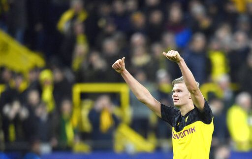 Dortmund's Erling Braut Haaland gives thumbs up at the end of the Champions League round of 16 first leg soccer match between Borussia Dortmund and Paris Saint Germain in Dortmund, Germany, Tuesday, Feb. 18, 2020.