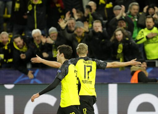 Dortmund's Erling Braut Haaland, right, celebrates after scoring his side's second goal during the Champions League round of 16 first leg soccer match between Borussia Dortmund and Paris Saint Germain in Dortmund, Germany, Tuesday, Feb. 18, 2020.